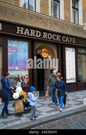 Tourists in front of the popular Hard Rock Cafe in the historic house 'U Rotta' in the Old Town of Prague. - Stock Photo