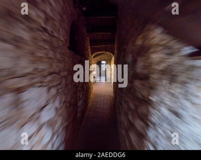 Running through narrow corridor medieval fort Trsat in Rijeka Croatia Europe - Stock Photo