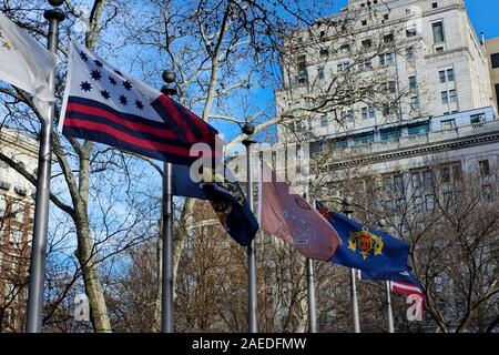 Flags wave on a windy day in Washington Square Park, Philadelphia, PA.