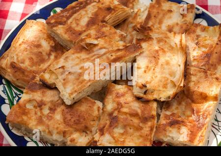 Pieces of traditional homemade filo pastry filled with white cheese - Stock Photo