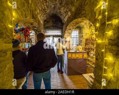 Festive illumination shop inside Trsat fort in Rijeka in Croatia - Stock Photo