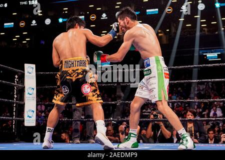 Brooklyn, New York, USA. 7th Dec, 2019. MARLON TAPALES (yellow and black trunks) battles RYOSUKE IWASA in a junior featherweight bout at the Barclays Center in Brooklyn, New York. Credit: Joel Plummer/ZUMA Wire/Alamy Live News - Stock Photo