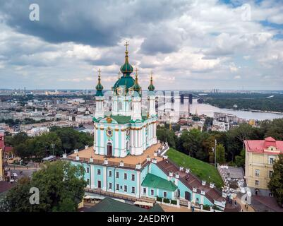 Aerial top view of Saint Andrew's church and Andreevska street from above, cityscape of Podol district, city of Kiev (Kyiv), Ukraine. - Stock Photo