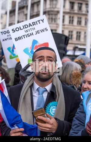 London, UK. 8th December 2019. Together Against Antisemitism demonstration and rally in Parliament Square. Jews and non Jews came together to stand against Antisemitism and were addressed by 5 speakers. Organisers were the Campaign Against Antisemitism, who estimated 3,200 people were present. Pictured at the rally, Jewish Brexit Party Parliamentary Election Candidate Yosef David, who is standing against Jeremy Corbyn in Islington North. Credit: Stephen Bell/Alamy - Stock Photo