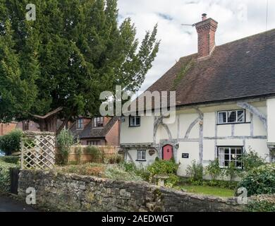 An ancient timber framed cottage and garden in the village of Weavering, Kent, UK - Stock Photo
