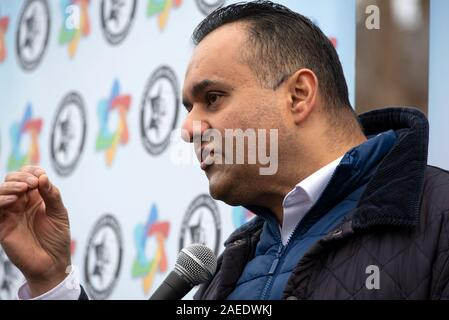 London, UK. 8th December 2019. Together Against Antisemitism demonstration and rally in Parliament Square. Jews and non Jews came together to stand against Antisemitism and were addressed by 5 speakers. Organisers were the Campaign Against Antisemitism, who estimated 3,200 people were present. Pictured speaking at the rally, Fiyaz Mughal, founder of Muslims against Antisemitism. Credit: Stephen Bell/Alamy Stock Photo