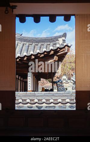 DEC 16, 2016 Seoul, South Korea - Traditional Hanok style Korean House at Namsan Hanok village seen through window frame. - Stock Photo