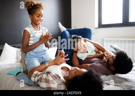 Young family being playful and spending fun time together at home - Stock Photo