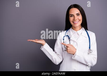 Close-up portrait of her she nice attractive cheery brunet girl holding on palm demonstrating medical meds pill painkiller medication pharmacy - Stock Photo