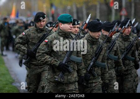 Bucharest, Romania - December 01, 2019: Polish soldiers with Beryl assault rifles take part at the Romanian National Day military parade. - Stock Photo