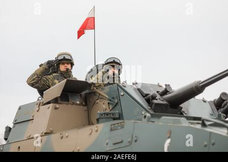 BUCHAREST, ROMANIA - December 1, 2019: Polish soldiers in a ROSOMAK armored vehicle at the Romanian National Day military parade. - Stock Photo