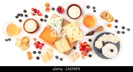 Cheese board panorama with wine and fruit, a flat lay, shot from the top on a white background - Stock Photo