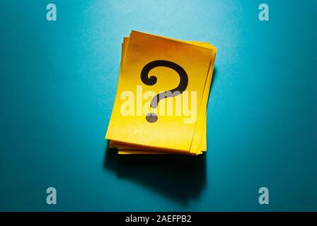 Stack of colorful yellow cards with question mark - Stock Photo