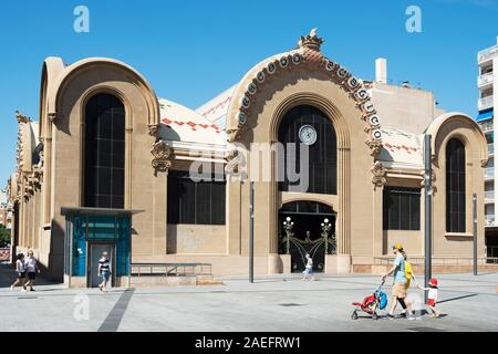 TARRAGONA, SPAIN - SEPTEMBER 23, 2018: A view of the main facade of the historical Central Public Market of Tarragona, and the Corsini Square, in Tarr - Stock Photo