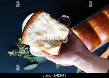 Food Baking concept Fresh baked organic homemade soft milk loaf bread in loaf pan with copy space - Stock Photo