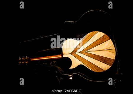 A hand made guitar inside the case Stock Photo