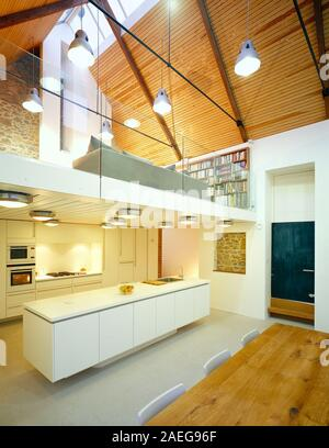 Architecture. Modern residential interior with kitchen diner, mezzanine living area and cathedral ceiling. - Stock Photo