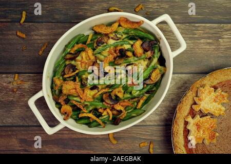 Homemade Green bean Casserole topped with crispy  fried onions, overhead view - Stock Photo