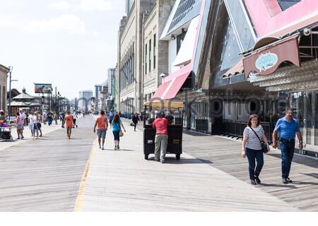 Taking a photographic walk on the Boardwalk with hotels and casinos at the Waterfront in Atlantic City, New Jersey. USA - Stock Photo