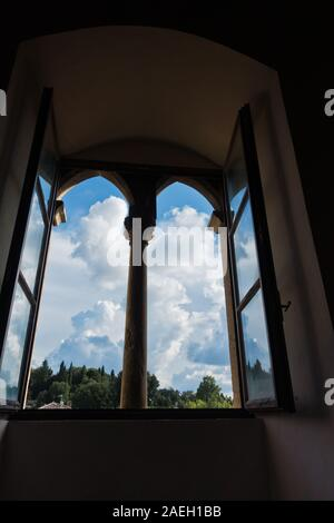 Window with a view inside Priori palace in Volterra, which is the oldest city council hall in Tuscany, Italy - Stock Photo