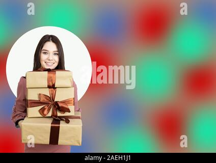 Beautiful brunette with gifts in her hands on a spotty bright creative background. - Stock Photo