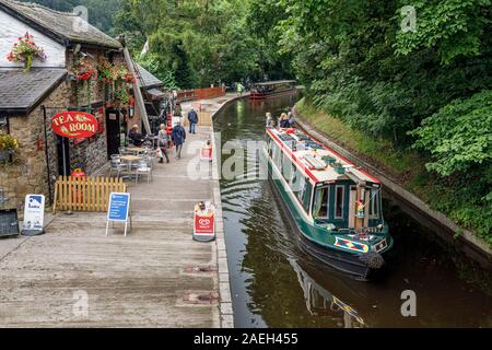 A sightseers' narrowboat passing Llangollen Wharf on the Llangollen Canal, Denbighshire, Wales - Stock Photo