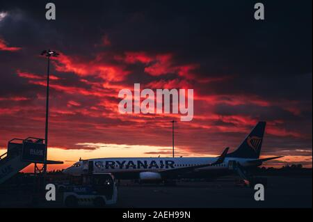 London, England - February 27, 2019: Ryanair Airplane at the airport, beautiful dramatic sky in background.