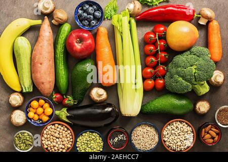 Healthy food for vegan and vegetarian nutrition. The concept of clean eating diet. A variety of vegetables, fruits, legumes, cereals, seeds, nuts, ber - Stock Photo
