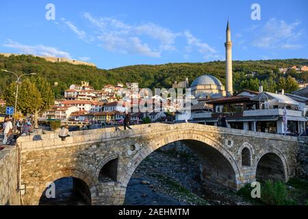 Looking across to The old town of Prizren and The Sinan Pasha Mosque from the stone bridge across the Bistrica river. in Kosovo, central Balkans.