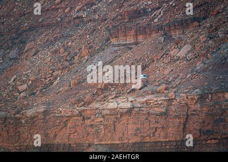 A van on the White Rim Trail, Canyonlands National Park - Stock Photo