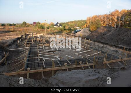 Wooden formwork concrete strip foundation for a cottage. - Stock Photo