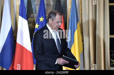 Paris, France. 09th Dec, 2019. Russia Foreign Minister Sergey Lavrov takes his place for the start of the Normandy Format Summit meeting at the Elysee Palace December 9, 2019 in Paris, France. The summit is hosted by French President Emmanuel Macron and German Chancellor Angela Merkel in an effort to find an end to the war in Ukraine. Credit: Alexei Nikolsky/Kremlin Pool/Alamy Live News - Stock Photo