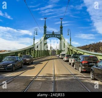 BUDAPEST, HUNGARY - MARCH 2019: Tram tracks and cares queuing on the road surface of the Liberty Bridge or Freedom Bridge, in Budapest - Stock Photo