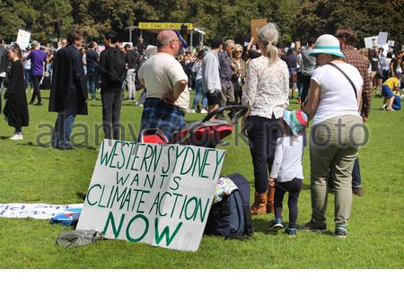 Climate change strike. Group of protestors standing behind a sign reading 'Western Sydney wants climate action now' - Stock Photo