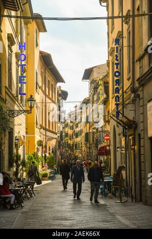 Street view of Via Faenza in the San Lorenzo district, historic centre of Florence, with people and tourists in sidewalk café, Tuscany, Italy - Stock Photo