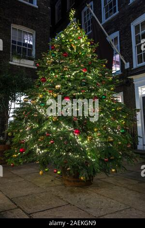 London, UK - December 9th 2019: A beautiful Christmas Tree on display in Pickering Place in London, UK.  Pickering Place is the smallest square in Lon - Stock Photo