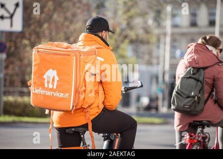VIENNA, AUSTRIA - NOVEMBER 6, 2019: Lieferservice logo on a delivery guy in Vienna. Also called Lieferando, it is a subsidiary of Takeaway.com, a Dutc