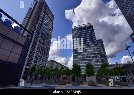 Amsterdam, Holland, August 2019. Several modern skyscrapers are located in the modern suburbs of the city. With extensive use of glass and steel they - Stock Photo