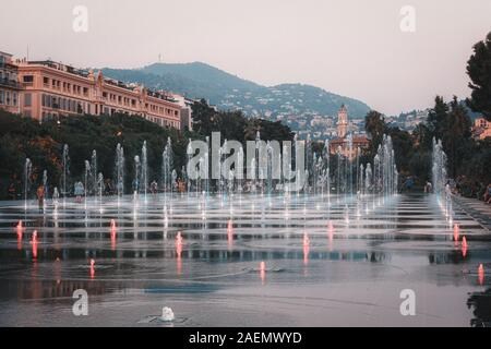 Nice, France, September 20, 2018:  The illuminated Miroir d'eau fountain on the promenade du Paillon in the center of Nice - Stock Photo