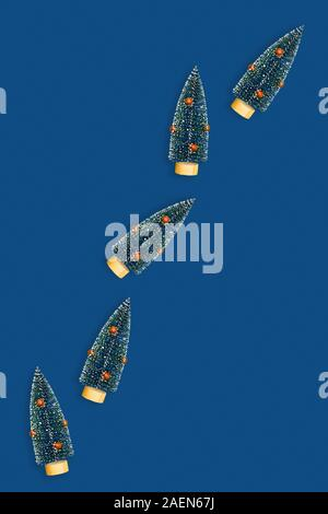 Christmas and New year classic blue decorative background with christmas trees. Flat lay, top view, copy space. - Stock Photo