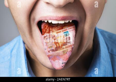 The texture of Russian money in human tongue. Language is a means of earning a public person - Stock Photo