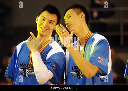 --FILE--Ji Zhe, left, and Zhai Xiaochuan, right, players of Beijing Duck, show their CBA championship rings in Beijing, China, 24 November 2012. Former Beijing Ducks' player Ji Zhe, three-time winner of the Chinese Basketball Association league, died of lung cancer early on 5 December 2019. - Stock Photo