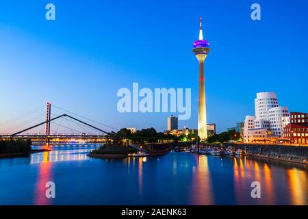 Rheinturm and Media Harbour district in Dusseldorf city in Germany - Stock Photo