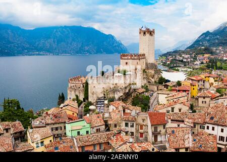 Scaliger Castle or Castello Scaligero is a medieval fortress in the Malcesine old town on the shore of Lake Garda in Verona province, Italy - Stock Photo
