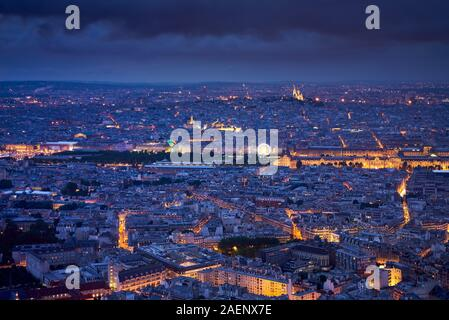 Paris aerial view at twilight with the Jardins des Tuileries, Le Louvre and Montmartre Sacré-Coeur. Rooftops of Paris, 1st, 7th, 18th Arrondissements - Stock Photo