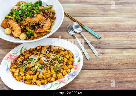 Mala Xiang Guo (stir-fry pot), and Mapo Toufu (bean curd), China Chinese Sichuan Chengdu Chongqing spicy food on table. - Stock Photo