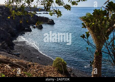 Small secluded stony beach in Alcala on the west coast of Tenerife, Canary Islands, Spain - Stock Photo