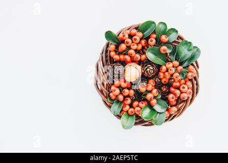 Beautiful eco friendly Christmas wreath on white background. Creative festive garland with pine cones, willow and cotoneaster branches. Space for text - Stock Photo