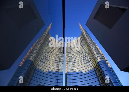 Unicredit tower reflected in a window, Porta Nuova, Milan, Italy - Stock Photo