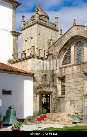 The tower and small garden courtyard of the Se do Porto, Porto's cathedral, in the city of Porto, Portugal. - Stock Photo